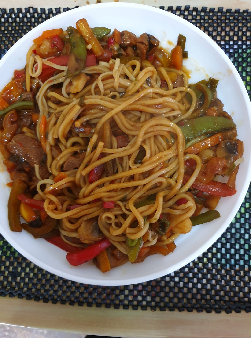 Main meal of Korean style noodles with extra stir fry vegetables.